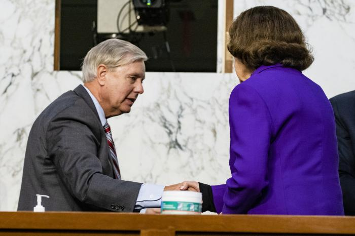 Sen. Lindsey Graham, R-S.C., shakes hands with Sen. Dianne Feinstein, D-Calif., at the close of the confirmation hearing for Supreme Court nominee Amy Coney Barrett, before the Senate Judiciary Committee.