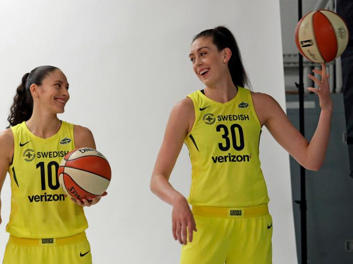 In this May 9, 2018, file photo, Seattle Storms players Sue Bird, left, and Breanna Stewart smile as pose a photo session during the WNBA basketball team's media day in Seattle