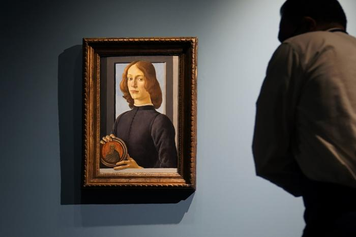 """Sandro Botticelli's 15th-century painting called """"Young Man Holding a Roundel"""" is displayed at Sotheby's, in New York."""