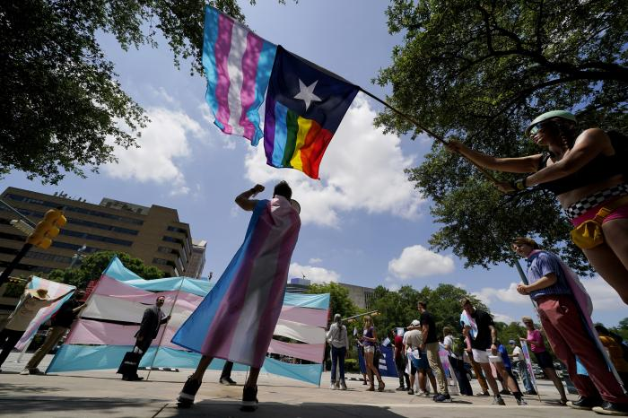 Demonstrators gather on the steps to the State Capitol to speak against transgender-related legislation bills being considered in the Texas Senate and Texas House in Austin, Texas.