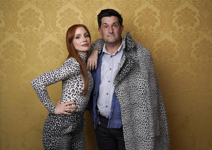 """Jessica Chastain, left, the star of """"The Eyes of Tammy Faye,"""" poses for a portrait with director Michael Showalter during the 2021 Toronto International Film Festival."""